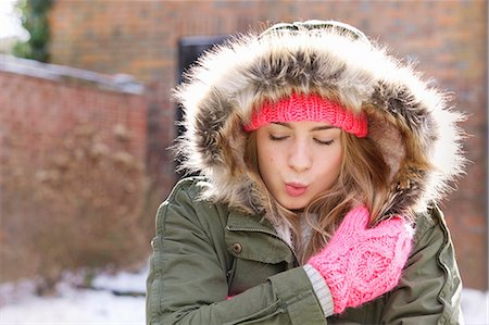 Teenage Girl Wearing Parka Hugging Herself Outdoors Stock Photo - Rights-Managed, Code: 822-07117437