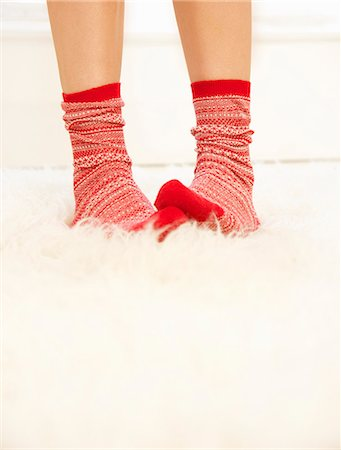 female feet close up - Woman's Feet with Red and White Wool Socks on Fluffy Rug Stock Photo - Rights-Managed, Code: 822-07117477