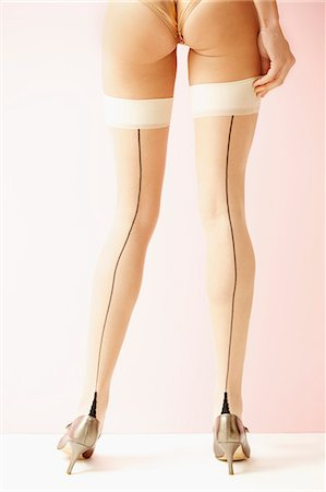 Back View of Woman Wearing Stockings and High Heels, Low Section Stock Photo - Rights-Managed, Code: 822-07117472