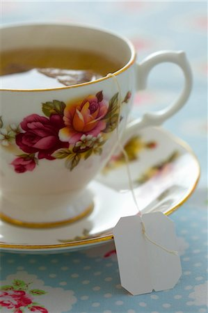Floral Pattern Tea Cup with Green Tea Stock Photo - Rights-Managed, Code: 822-07117496