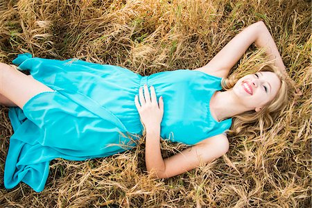 Smiling Woman Lying in Grass Stock Photo - Rights-Managed, Code: 822-07117503