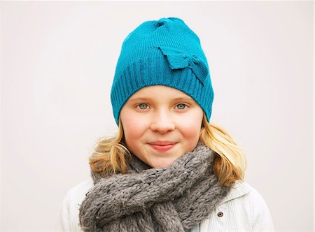 Portrait of Young Girl Wearing Wool Hat and Scarf Stock Photo - Rights-Managed, Code: 822-07117548