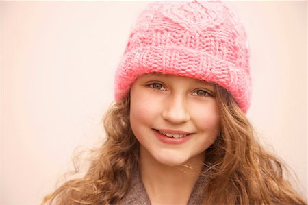 Smiling Young Girl Wearing Pink Wool Hat Stock Photo - Rights-Managed, Code: 822-07117549