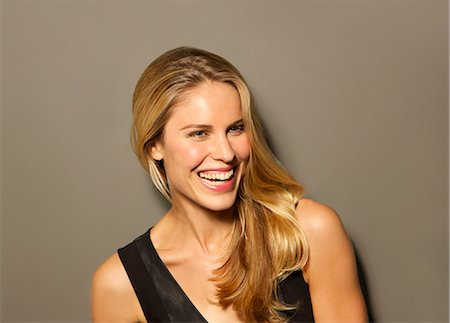 Attractive Blonde Woman Smiling Stock Photo - Rights-Managed, Code: 822-07355404