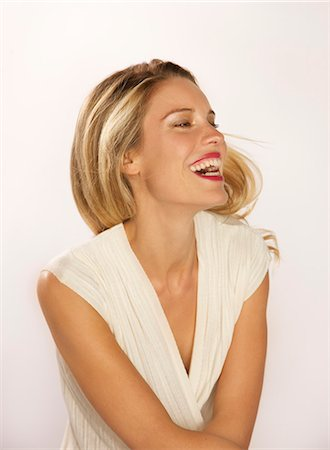 Attractive Blonde Woman Smiling Stock Photo - Rights-Managed, Code: 822-07355407