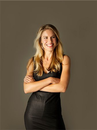 Attractive Blonde Woman with Arms Crossed Smiling Stock Photo - Rights-Managed, Code: 822-07355403
