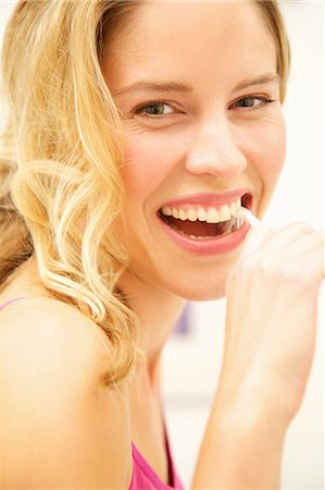 expressive - Smiling Woman Brushing Teeth Stock Photo - Rights-Managed, Code: 822-07355417