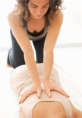 southeast asian ethnicity - Woman Receiving a Thai Yoga Massage Stock Photo - Rights-Managed, Code: 822-07355425