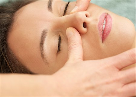 Woman Receiving a Facial Massage, Close-up View Stock Photo - Rights-Managed, Code: 822-07355421