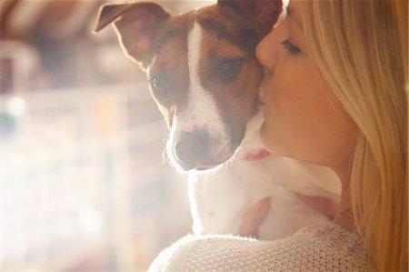 dog kissing girl - Young Woman Kissing Dog Stock Photo - Rights-Managed, Code: 822-07355456