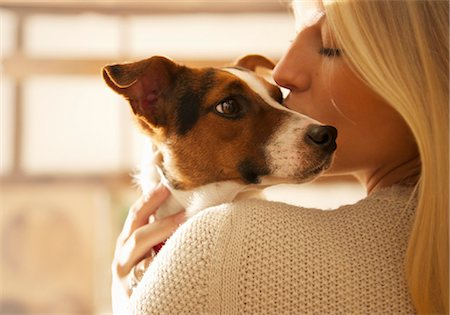 dog and woman and love - Young Woman Kissing Dog Stock Photo - Rights-Managed, Code: 822-07355457