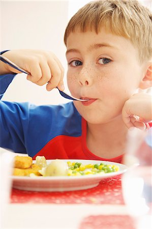 people eating at lunch - Young Boy Eating Fish fingers and Vegetables Stock Photo - Rights-Managed, Code: 822-07355466
