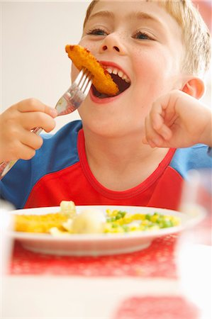 eating - Young Boy Eating Fish fingers and Vegetables Stock Photo - Rights-Managed, Code: 822-07355467