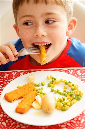 eating - Young Boy Eating Fish fingers and Vegetables Stock Photo - Rights-Managed, Code: 822-07355468