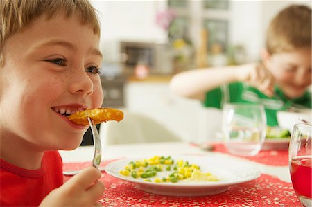 Young Boy Eating Fish fingers and Vegetables Stock Photo - Rights-Managed, Code: 822-07355471