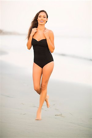 Attractive Woman Walking on Beach Stock Photo - Rights-Managed, Code: 822-07355509