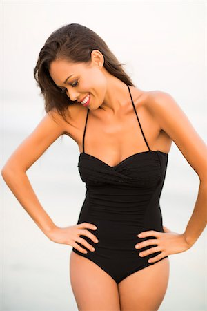 Woman Wearing Black Swimsuit with Hands on Hips Stock Photo - Rights-Managed, Code: 822-07355512
