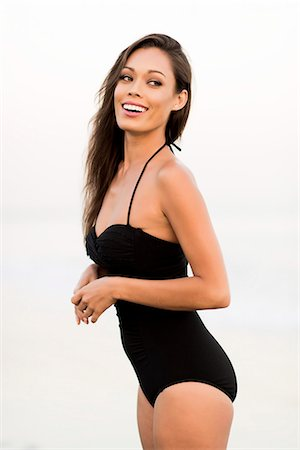 Smiling Woman Wearing Black Swimsuit Stock Photo - Rights-Managed, Code: 822-07355513