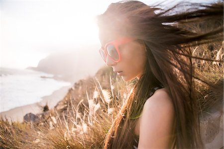 sunglasses - Profile of Woman with Windswept Hair Stock Photo - Rights-Managed, Code: 822-07355576
