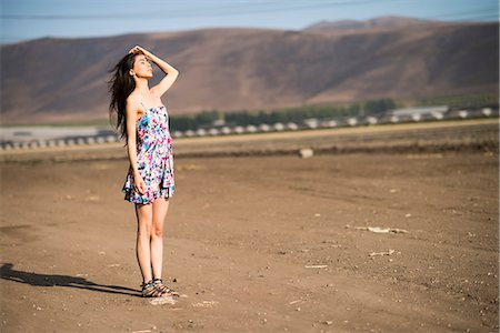 desert people dress photos - Woman Standing on Dry Field Stock Photo - Rights-Managed, Code: 822-07355571