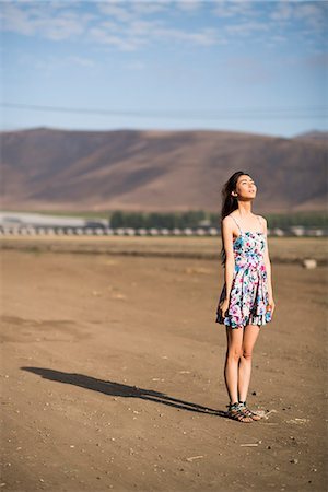 desert people dress photos - Woman Standing on Dry Field Stock Photo - Rights-Managed, Code: 822-07355572