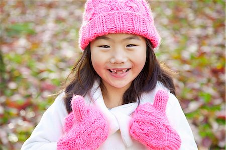 east asian - Smiling Young Girl Giving Thumbs Up Stock Photo - Rights-Managed, Code: 822-07355615