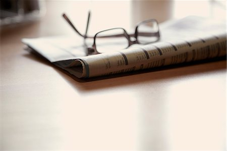 Eyeglasses on Newspaper Stock Photo - Rights-Managed, Code: 822-07355636