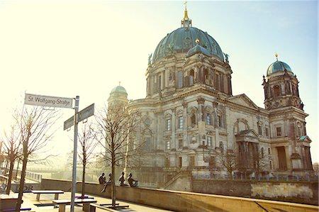 """""""Drei Mädchen und ein Knabe"""" (Three Girls and a Boy) by Wilfried Fitzenreiter, 1988, Berlin Cathedral in background Stock Photo - Rights-Managed, Code: 822-07355641"""