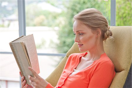 Young Woman Reading Book Stock Photo - Rights-Managed, Code: 822-07562535