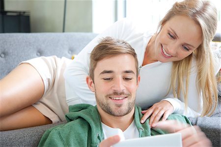 partnership - Couple on Sofa Using Smartphone Stock Photo - Rights-Managed, Code: 822-07562541