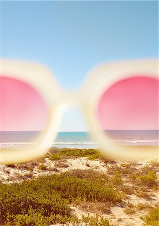 Cropped View of Rose-Coloured Sunglasses with Beach in the background Stock Photo - Rights-Managed, Code: 822-07562563