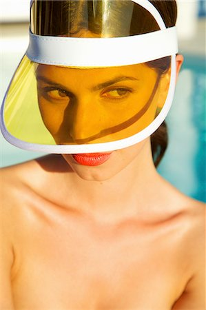 Woman with Red Lips Wearing Yellow Visor Stock Photo - Rights-Managed, Code: 822-07562585