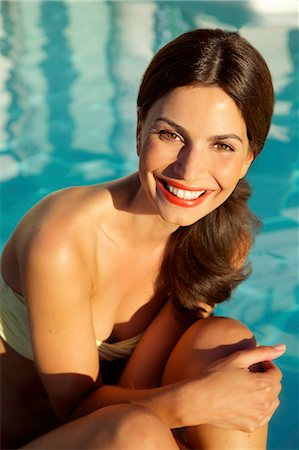 Smiling Woman by Swimming Pool Stock Photo - Rights-Managed, Code: 822-07562586