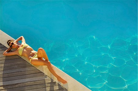 swimming pool water - Woman Sunbathing by Swimming Pool, High Angle View Stock Photo - Rights-Managed, Code: 822-07562583