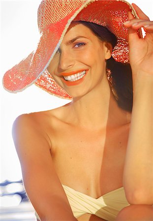 Smiling Woman Wearing Wide Brim Hat Stock Photo - Rights-Managed, Code: 822-07562590
