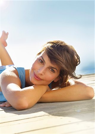 Smiling Woman Lying Outdoors Stock Photo - Rights-Managed, Code: 822-07562609