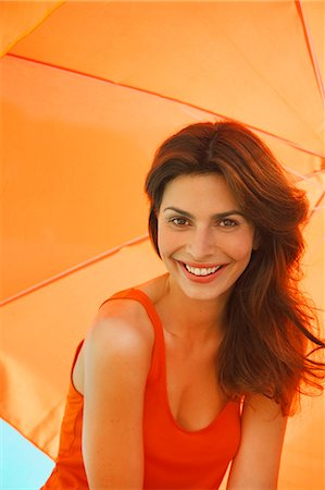 Smiling Woman Under Orange Parasol Stock Photo - Rights-Managed, Code: 822-07562603