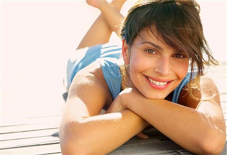 Smiling Woman Lying Outdoors Stock Photo - Rights-Managed, Code: 822-07562610