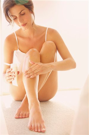 Woman Applying Body Lotion on Leg Stock Photo - Rights-Managed, Code: 822-07562624