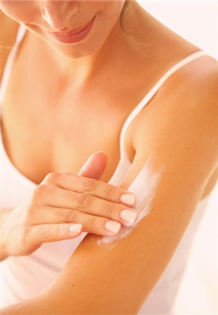 personal care - Woman Applying Body Lotion on Arm Stock Photo - Rights-Managed, Code: 822-07562625