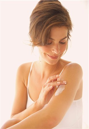 personal care - Woman Applying Body Lotion on Arm Stock Photo - Rights-Managed, Code: 822-07562626