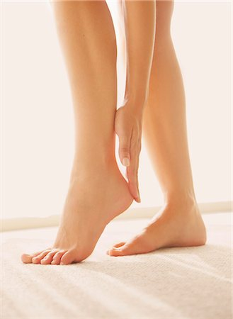 female feet close up - Woman Applying Body Lotion on Heel, Low Section Stock Photo - Rights-Managed, Code: 822-07562622