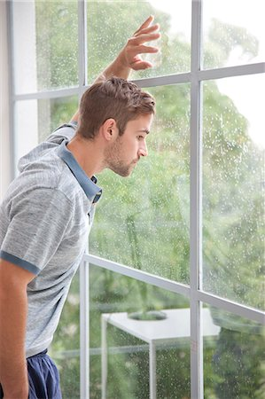 drop - Man Looking out of Window Stock Photo - Rights-Managed, Code: 822-07562638