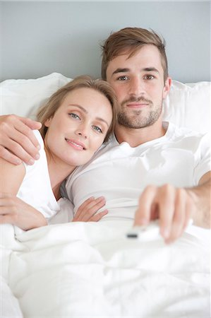 Couple in Bed Watching TV Stock Photo - Rights-Managed, Code: 822-07562644