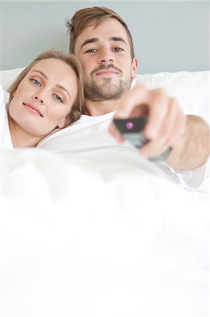 Couple in Bed Watching TV Stock Photo - Rights-Managed, Code: 822-07562647
