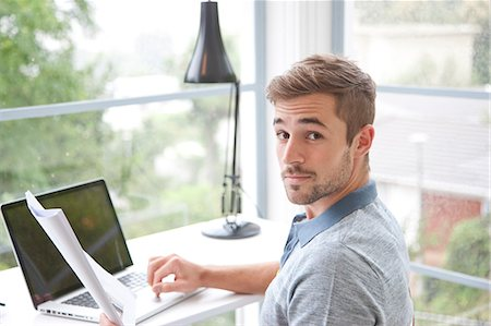 Man Sitting at Desk in Home Office Stock Photo - Rights-Managed, Code: 822-07562642