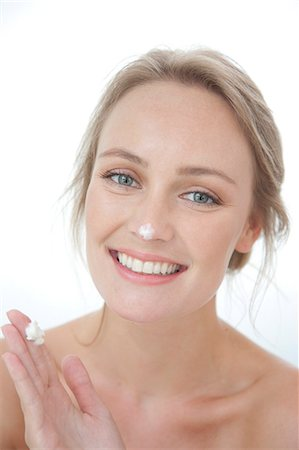 personal care - Smiling Woman with Moisturizing Cream on Nose Stock Photo - Rights-Managed, Code: 822-07562657