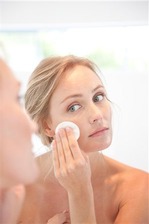 personal care - Woman Using  Cleansing Cotton Pad on Face Stock Photo - Rights-Managed, Code: 822-07562659