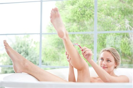 personal care - Woman in Bathtub Shaving Legs Stock Photo - Rights-Managed, Code: 822-07562670