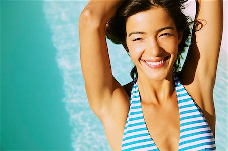 Smiling Young Woman Sunbathing, Close-up View Stock Photo - Rights-Managed, Code: 822-07562724